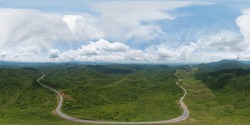 360 panorama by 180 degrees angle seamless panorama of aerial view of cars driving on curved, zigzag curve road or street on mountain hill with green natural forest trees in rural area of Nan,Thailand