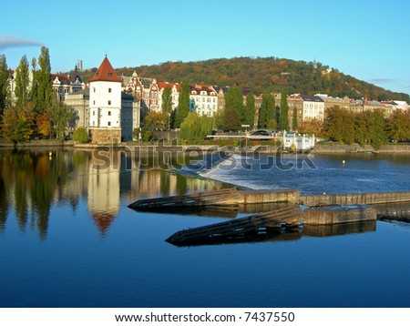 Panoramatic photo of the city of Prague with a view at Vltava River - stock photo