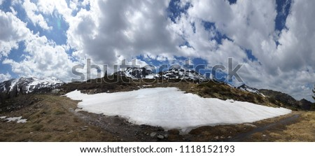 panoramic view of a Big flake of snow on the way to Pic Barthelemy in the south of France in early spring