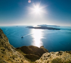 Panoramic view on Tholos Naftilos and Therasia near to Santorini island,   Greece.