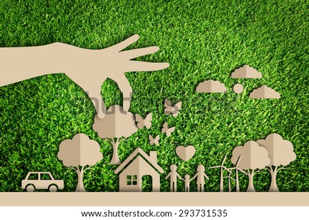 Stock Photo  Paper cut of eco on green grass