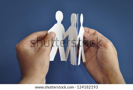 'Paper people' in the hand