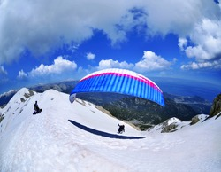 Paraglider flying from Tahtali mountain , Turkey