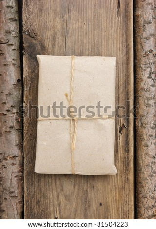 parcel wrapped with brown kraft paper and tied with twine