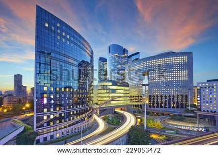 Paris. Image of office buildings in modern part of Paris during sunset.