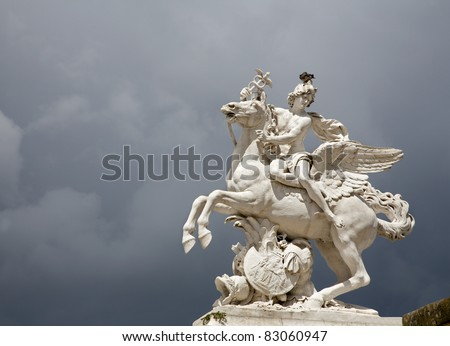 Paris - statue  from entry of Tuileries garden and strom clouds