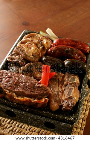 """Parrillada"" Argentine barbecue make on live coal (no flame), beef ""asado"" in front, back left ""chinchulin"" (lamb intestines), back right sausage ""Chorizo"" and blood sausage ""morcilla"""