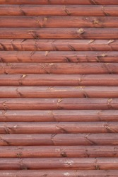 Part of a wooden wall from parallel boards shot vertically. For design.