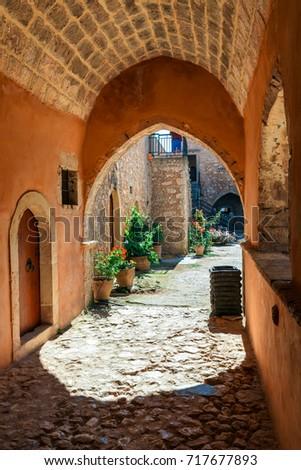 Passageway in the West Gate at the Arkadi Monastery, Arkadi, Crete, Greece #717677893