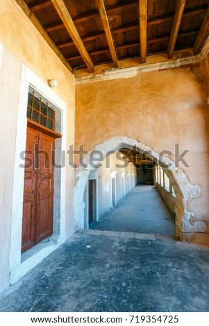 Passageway in the West Gate at the Arkadi Monastery, Arkadi, Crete, Greece #719354725