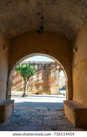 Passageway in the West Gate at the Arkadi Monastery, Arkadi, Crete, Greece #736114459