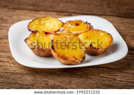 (Pastel de nata or Pastel de belém). Traditional Portuguese dessert. Foto stock ©