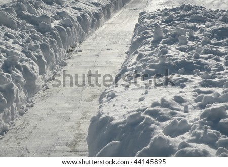 path shoveled of deep snow