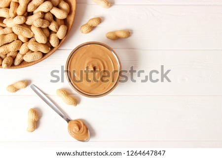 peanut butter and peanut beans on wooden background #1264647847