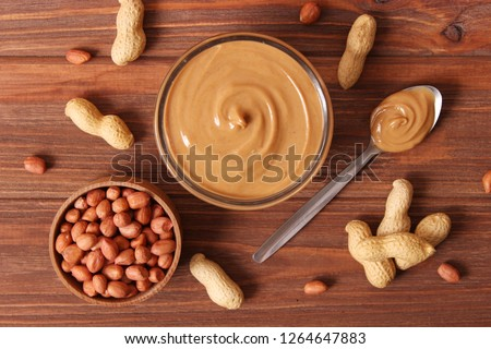 peanut butter and peanut beans on wooden background #1264647883