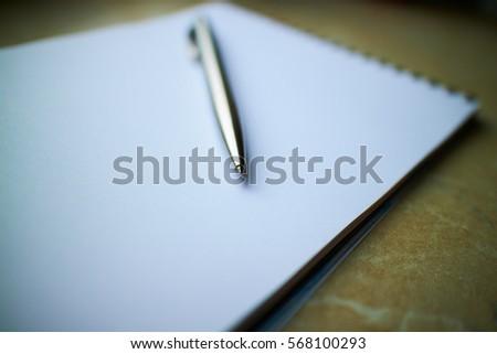 pen in a notebook  #568100293