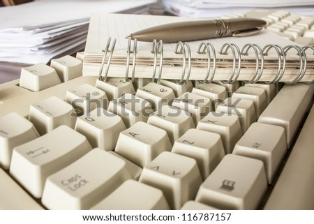 pen, notebook and keyboard,office