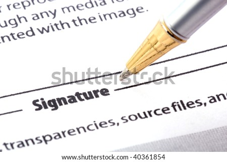pen signing form - stock photo