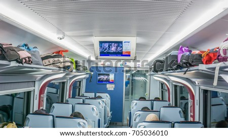 Penang, Malaysia -AUGUST 25TH, 2017:inside view of the train in KTM ETS train. The KTM ETS is an inter-city rail service operated in Malaysia and is the fastest train in the country. #705036010