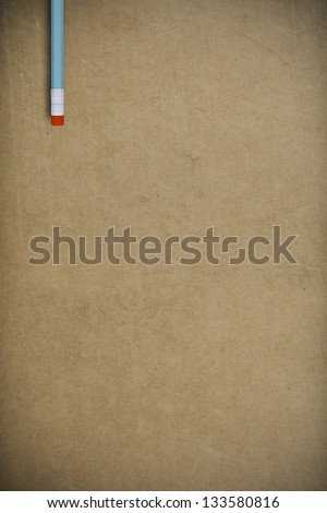 pencil on  grunge packing paper background