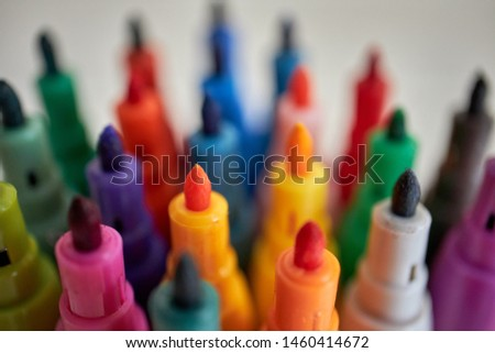 Pencils, markers and waxes of various colors for school
