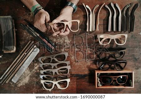 People doing wood sunglasses production Photo stock ©