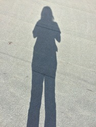 People shadows with reflection on the ground