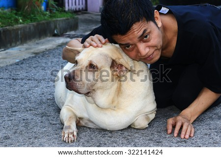 People with dog fat cute\ \ \ \ \ \ \ \ \ \ \ \ \ \ \ \ \ \ \ \ \ Friendship between man and dog.