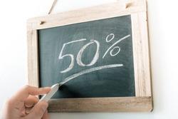 50 Percent Handwritten With Chalk On A Blackboard