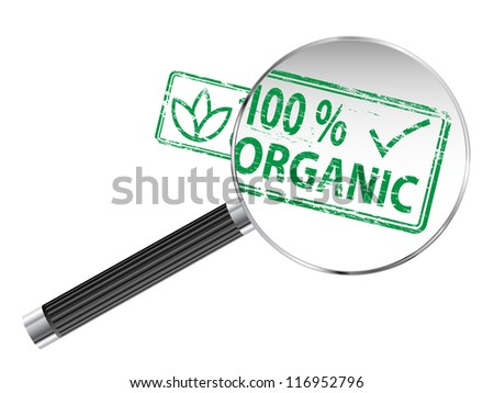 100 Percent Organic rubber stamp under a magnifying glass