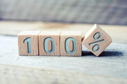 100 Percent Written On Wooden Blocks On A Board