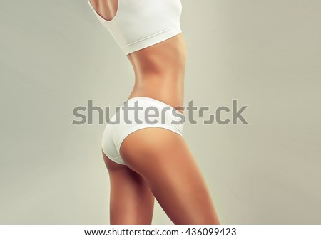 Perfect slim toned young body of the girl . An example of sports , fitness or plastic surgery and aesthetic cosmetology. #436099423