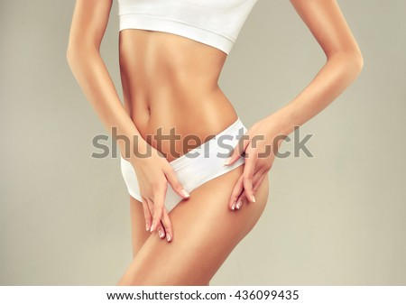 Perfect slim toned young body of the girl . An example of sports , fitness or plastic surgery and aesthetic cosmetology.    #436099435