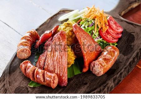 Peruvian gastronomy from the Amazon delicious traditional dishes Juane, Tacacho, Cecina, Maduro Frito and Smoked Chorizo Foto stock ©