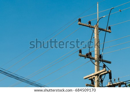3 phases powerlines pose with blue sky background #684509170