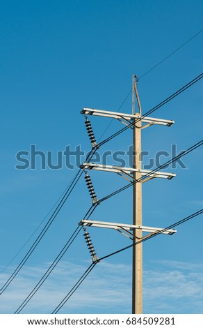 3 phases powerlines pose with blue sky background #684509281