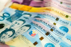 1000 Philippine pesos with other banknotes in the background