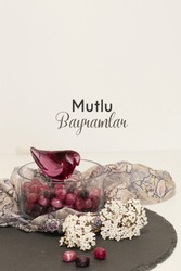 photo containing a Turkish text celebrating the ramadan holiday with a ramadan festival with candies in a glass jar