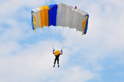 Photo of a parachutist soaring in the blue sky over Ukraine. Skydiving.