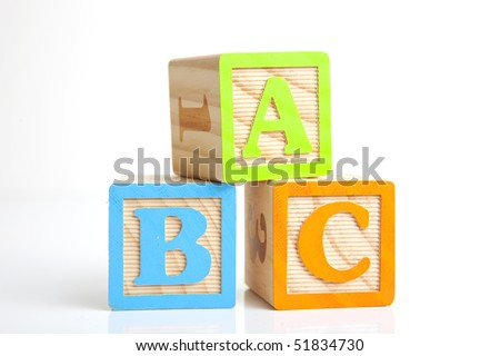 photo of a wooden alphabet blocks spelling abc - stock photo