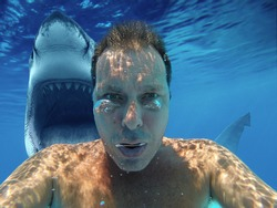 (photomanipulation)European man diving with shark. Scary selfie with shark under water. Shark behind his back with open jaw. most downloaded