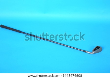 Picture of Golf Stick. Isolated on blue background.