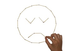 picture of matches in the form of a sad face with closed eyes