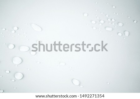 Picture of water droplets on white background.