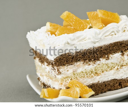 piece of cake lying on a saucer with the pieces of orange