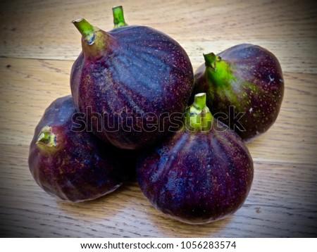 Pile of freshly picked figs                     #1056283574