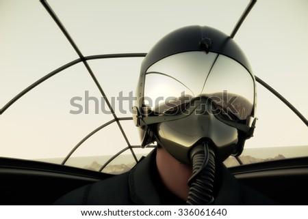 Pilot Wearing Mask And Helmet In Cockpit Of Fighter Jet.