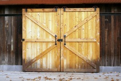 Pine barn door on rails with handles and lock