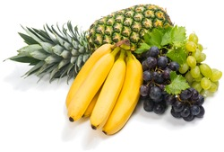 pineapple, banana and  grapes with leaves isolated on white