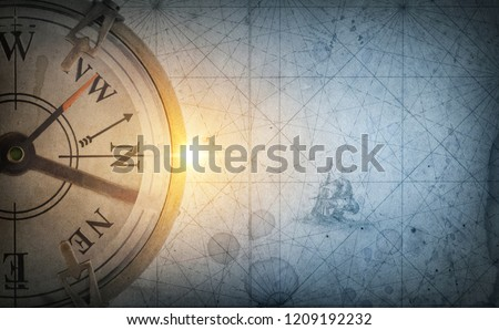 Pirate and nautical theme grunge background. Old sea compass on abstract map background. Retro style.